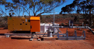 Red dirt outback setting for borehole pump setup.