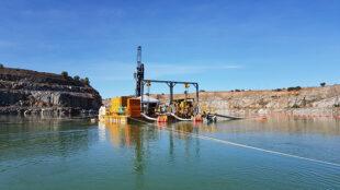 Pontoon pumping setup in FNQ mine site tailings pond.