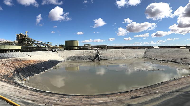 Blue skies over mine site dam where clean is underway.