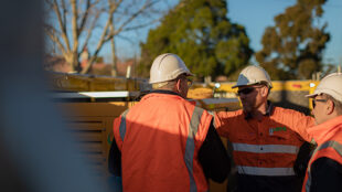 Team members from NPE on site in safety PPE and hi-Vis.