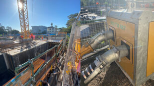 Sun up at the Sunshine Coast construction site - workers and the pump are in action.